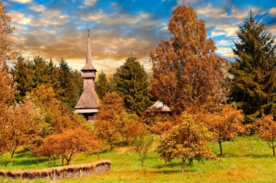 Wooden church on Dobaies in autumn. The Village museum near Sighlet, Maramures, Northern Transylvania